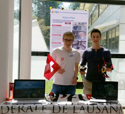 MotionPilot Team at their stand in Paris. L-R Arthur Gay (EPFL), Thibaut Paschal (EPFL). Missing from photo: Timothée Peter (EPFL)